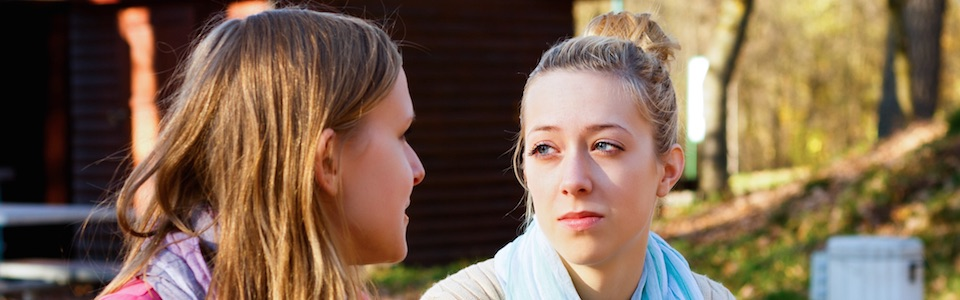 Header image of two women talking