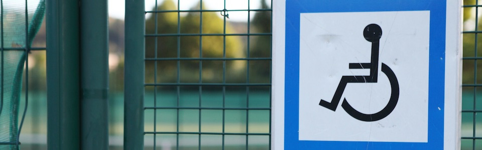 Header image of disabled sign outside tennis court