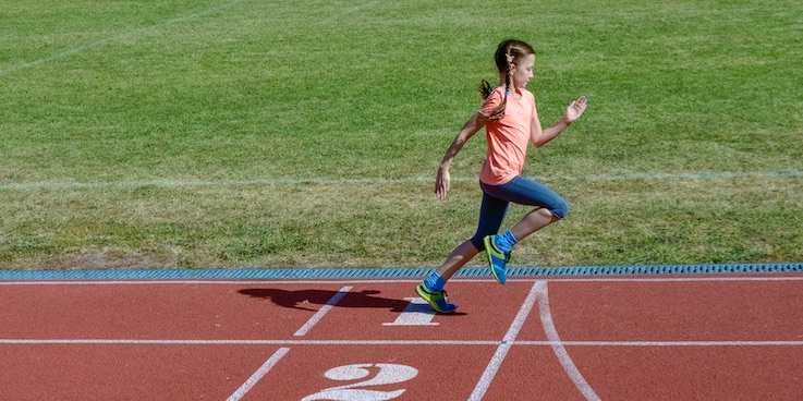 girl running on athletics track